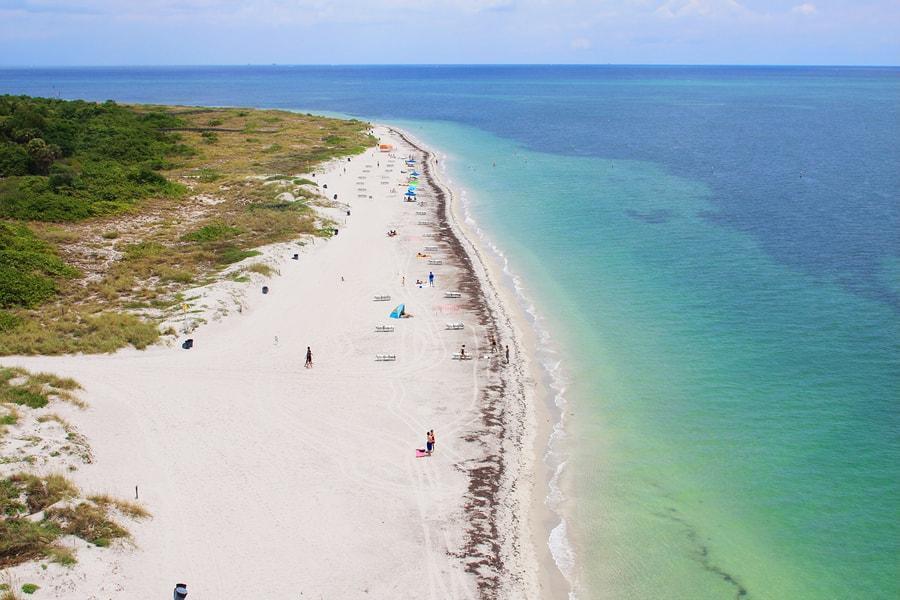 Aerial of Wiggins Pass beach Naples, FL
